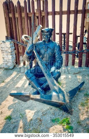 The Figure Of A Seated Pirate With An Anchor. Yeisk. Krasnodar Region. Russia. July 2019