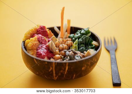 Closeup View Of Delicious Colorful Looking Vegan Meal Served In A Buddha Bowl Style Coconut Shell.