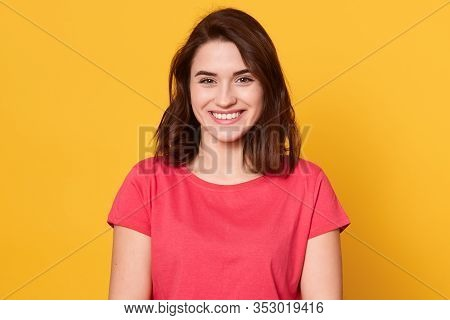 Picture Of Caucasian Brunette Woman Posing Isolated Over Yellow Background, Dark Haired Lady Looks S