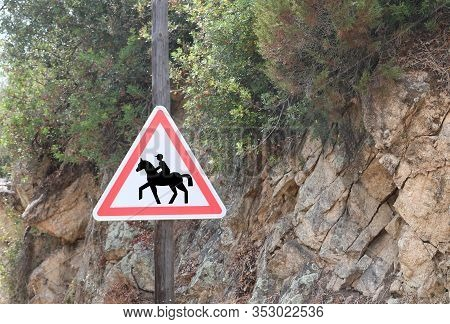 Road Sign With The Symbol Attention To The Crossing Of Horses Near An Equestrian Center