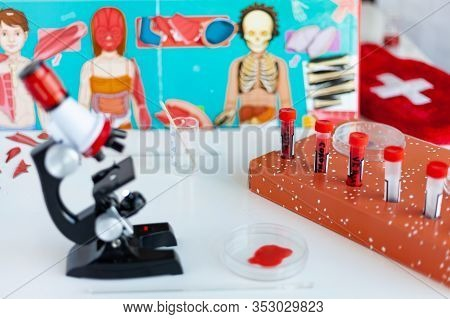 Toy Microscope Stands On A Table, Coronovirus Test Tubes, Optional Biologists, Preschool Education.