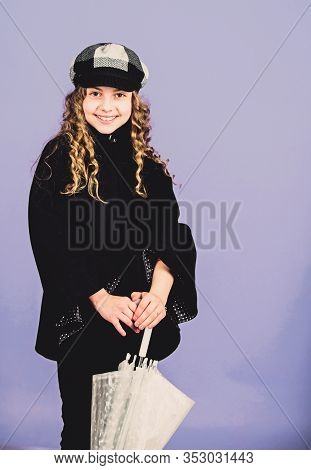 Love Rainy Days. Kid Girl Happy Hold Transparent Umbrella. Enjoy Rainy Weather With Proper Garments.