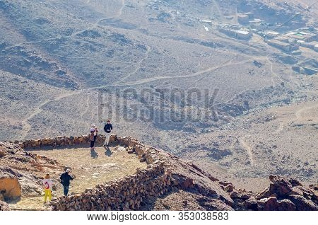 Sinai Peninsula, Egypt, May 9, 2019: Tourists Relax And Take Pictures On The Mountain Of Moses In Eg