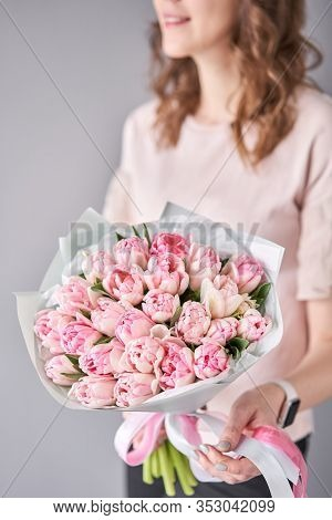 Pink Pastel Color Tulips In Woman Hand. Young Beautiful Woman Holding A Spring Bouquet. Bunch Of Fre