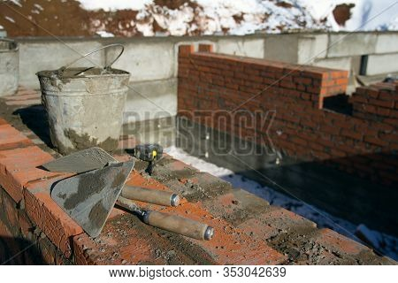 Workplace Of The Master In Masonry. Mason Trowel Close-up. Industrial Background