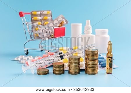 Stacks Of Coins In A Row Ascending, Shopping Cart Filled Medicinal Tablets And Pile Drugs On Blue Ba