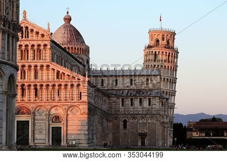 Pisa Tower And Cattedrale Di Santa Maria Assunta During Sunset.
