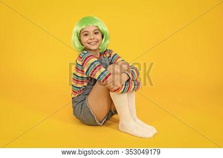 Stylish And Creative. Happy Child Wear Stylish Short Hair Wig Yellow Background. Little Girl Smile W