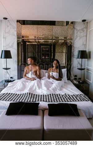 Couple Having Breakfast In Bed, Men And Woman In Luxury Room And White Bed Having Breakfast In Bed