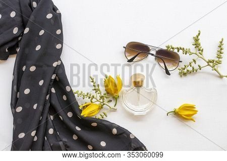 Bottle Perfume ,sunglasses, Black Scarf Scarf And Yellow Flower Ylang Ylang Of Lifestyle Woman Relax