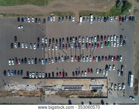 Parked Cars. The Drone Hovered Over The Parking Lot. Aerial View Of Vehicles Parked In A Car Park. V