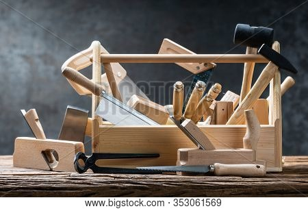 Toolbox With Carpenter Worktools Against Dark Background