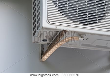 Air Conditioning Drainage Pipe Close-up.external Air Conditioning Unit.