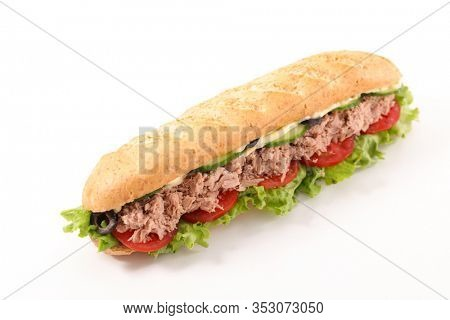 sandwich, babguette with tuna, tomato, lettuce, cucumber and sauce isolated on white background