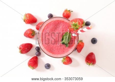 berry fruit smoothie- strawberry and blueberry smoothie on white background