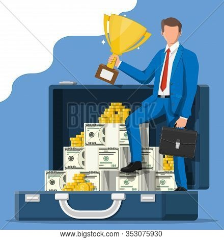 Successful Businessman In Suitcase With Dollar And Coins Holding Trophy, Celebrates His Victory. Bus