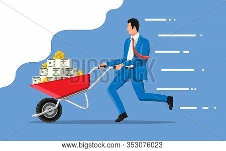 Businessman Pushing Wheelbarrow Full Of Money. Wheel Barrow Full Of Gold Coins And Dollar Banknotes.
