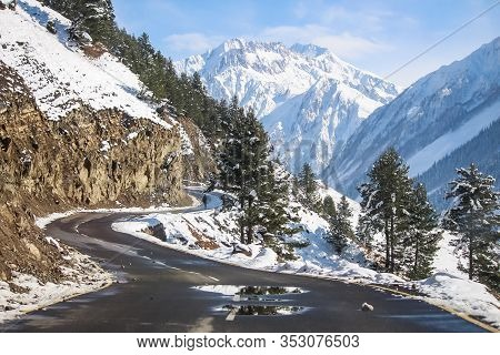 A Curvy Road Passing Through Snow Covered Mountains Of Himalayas At Drass. Srinagar-leh Highway. Bea