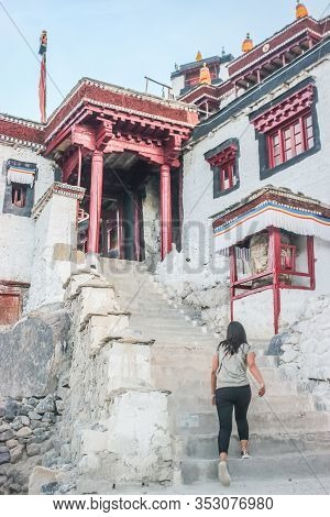 Thiksey, Ladakh, India- Dated:30 July, 2019- A Female Climbing The Stairs Leading To Individual Set