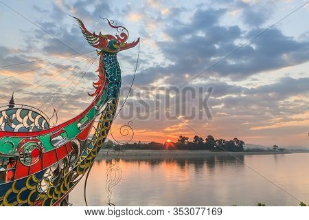 Ornamental Boat Prow And Sunrise Over Laos At The Golden Triangle, Chiang Khan, Thailand