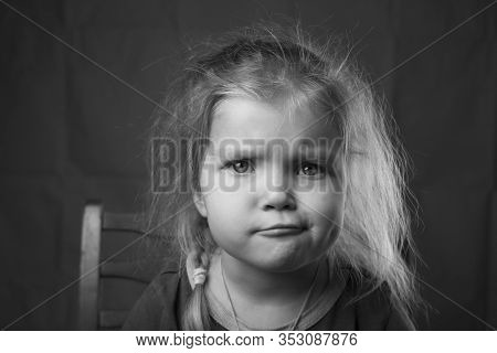 Black And White Portrait Beautiful Little Girl With Her Hair And A Skeptical Pensive Expression On H