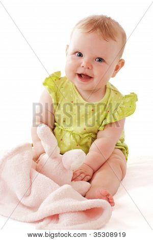 Pretty Laughing Blue Eyed Baby Sits And Plays With Soft Blanket