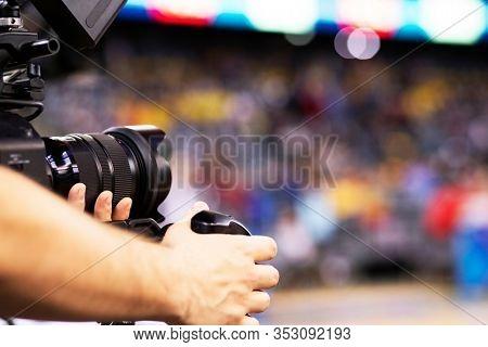 professional cameraman recording sporting event