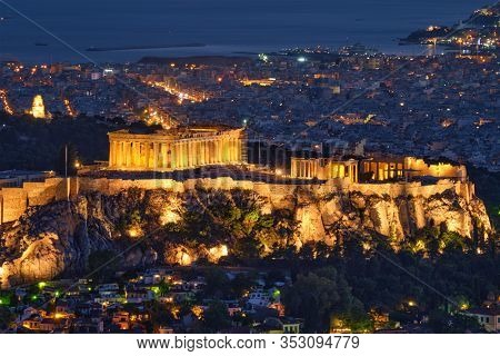 Famous greek tourist landmark - the iconic Athens view and Parthenon Temple at the Acropolis of Athens as seen from Mount Lycabettus, Athens, Greece