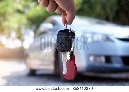 The Car Owner Is Standing The Car Keys To The Buyer. Used Car Sales