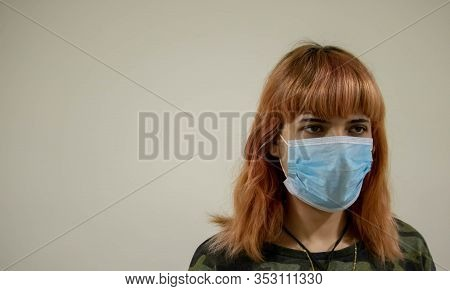Girl With Medical Mask To Protect Her From Virus. Coronavirus Pandemic. Woman With Mask Standing . P