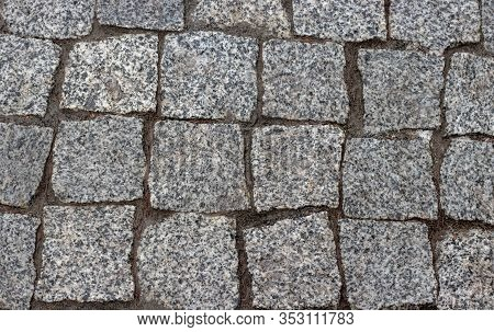 Granite Cobblestoned Pavement Background. Cobbled Stone Road Regular Shapes, Abstract Background Of