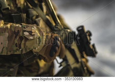 Army Commandos Soldier Man With Gun In The Winter Multicam Camouflage Is Patrolling Or Patrol Field