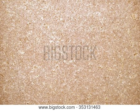 Granite Is Yellow-brown In Color With Small Light And Dark Specks, Uneven Scratches. The Texture Of