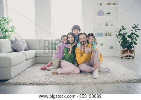 Portrait Of Nice Attractive Adorable Careful Cheerful Cheery Family Pre-teen Kids Mom Dad Sitting On