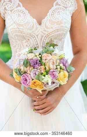 Bride With Bouquet, Closeup View. Wedding Bouquet, Wite Dress On Background.