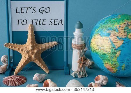 Globe, Starfish, Lighthouse And Shells On A Blue Background With Typography Lets Go To The Sea.