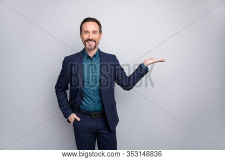 Photo Of Attractive Sales Manager Worker Man Advising Novelty Holding Innovation Product On Open Arm