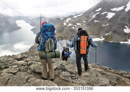 Jotunheimen, Norway - August 1, 2015: People Hike The Besseggen Trail In Jotunheimen National Park,