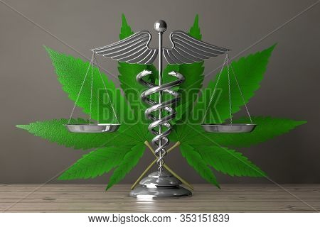 Medical Caduceus Symbol As Scales In Front Of Medical Marijuana Or Cannabis Hemp Leaf On A Wooden Ta