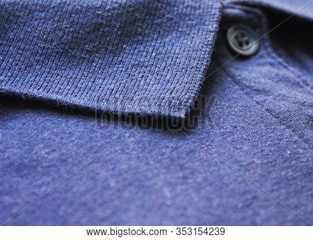 Dark Blue Polo Shirt Close Up. Plain Shirt Fabric Texture, Button-up Top With Collar Neck. Blue Cott