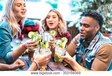 Best Friends Toasting Mojito Drinks At Fashion Cocktail Bar Restaurant - Party Time Concept With You