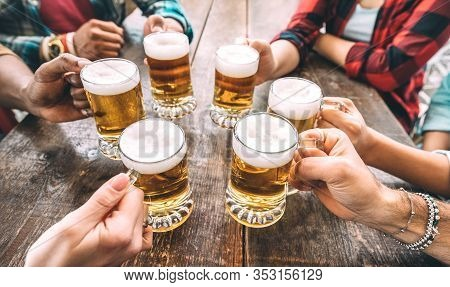 Friends Hands Toasting Beer Pints At Brewery Pub Restaurant - Beverage Concept With Young People Enj