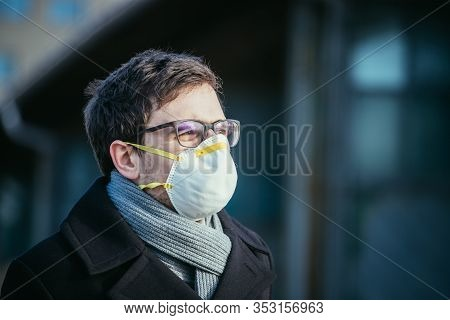 Flue And Corona Safety Concept. Man Wearing Face Mask To Protect Himself, Outdoors.