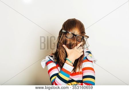 Studio Portrait Of Young Girl Fooling Around, Hiding Behind, Hair, Acting Silly, Time For Haircut, H