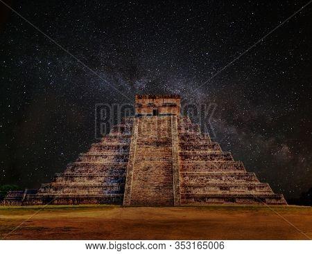 Mayan Pyramid Of Kukulcan El Castillo In Chichen Itza, Mexico At Night With Milky Way Galaxy. A Worl