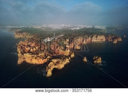 Aerial Distant View Photo Of Ponta Da Piedade Headland With Group Of Rock Formations Yellow-golden C