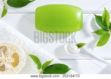 Natural Homemade Or Spa Skin Care Cosmetics: Glycerine Soap, Cream, Loofah Sponge And Towel On White