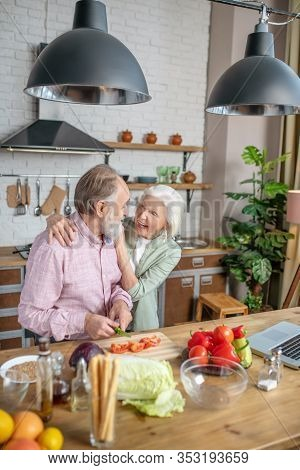 Lovely Elderly Couple Cooking Their Dinner Together