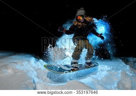 Female Freerider Doing Stunts On Blue Light Background