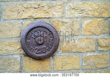 Geodetic mark(sign) on the brick wall (1936). The Kiev Fortress.It is considered the largest European fortress star. February 27, 2020, Kiev, Ukraine